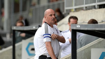 Mixed message Manager Paul Cook pulls on the captainÕs armband before the pre-season friendly at Dar