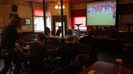Tension hangs in the air at the Rose Tavern, where fans are taking their seats for England's first final in 55 years.
