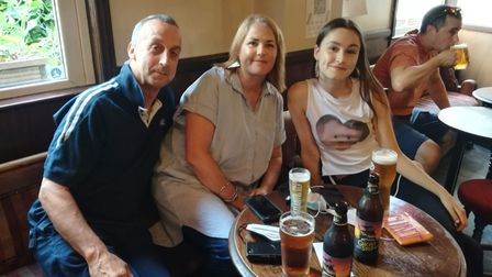 John, Nikki and Grace Easterbrook await the Euro 2020 final in the Rose.