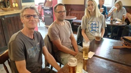 Roland Holmes (left) and Melanie Woolston (right) watch on in the Rose Tavern