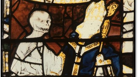 Stained glass window showing death seizing a bishop