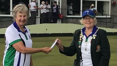 Madeira's latest County Badge winner Carolyn Parker presented her badge by the Bowls Devon Lady President