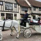 Lily Risley was all smiles as she waved to passers-by during her carriage ride in Sudbury and Long Melford
