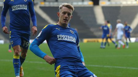 AFC Wimbledon's Joe Pigott celebrates scoring his side's first goal of the game during the Sky Bet L