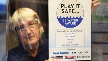 The Eastern Daily Press Water Safety awareness poster is put up in Barney's Newsagents in Sheringham