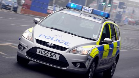 A Police car with blue lights on. Picture: Matthew Usher