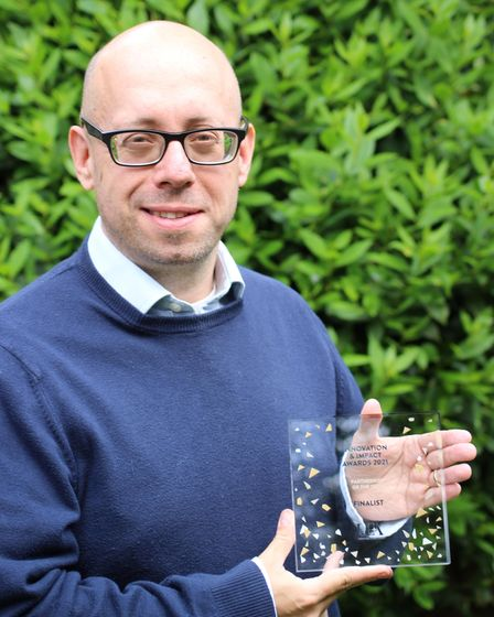 Mark Hitchcock,managingdirector, accepts the UEA Chancellor's Award for Outstanding Achievement