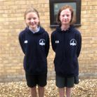 (L) Abbie Bristow and (R) Emily-Jane Bower, both 11-years-old, handed the wallet into Sutton One-Stop.