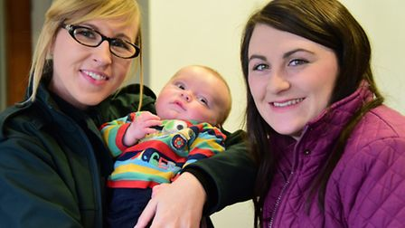 Eleven-week-old Reece Smith meets Anna Wisken, the ambulance call handler who helped deliver him wit