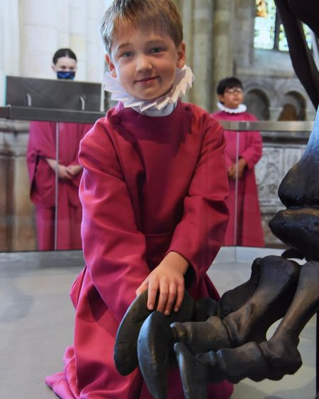 Nine-year-old Ralph Lambert-John places the last bone, a toe, to complete Dippy the Diplodocus at No