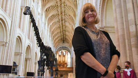 Lorraine Cornish, head of conservation at the Natural History Museum, with Dippy the Diplodocus in t