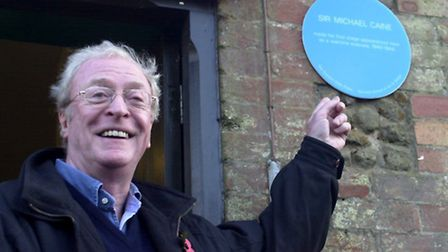 Flashback to 2003: A delighted Sir Michael Caine with the Blue Plaque he unveiled outside the school