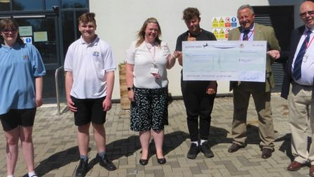 Masons hand over a cheque for £600 is handed to Highfield Littleport Academy
