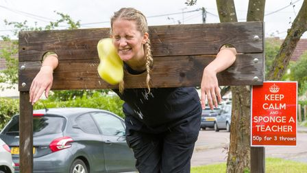 A teacher in the stocks, but someone as thrown a sponge at her!