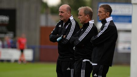 Paul Cook watches the warm-up at Bury Town
