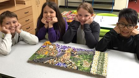 The children who created the winning well-dressing picture.