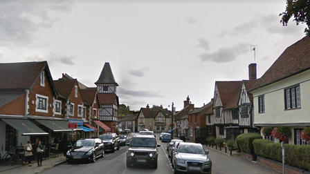 A Google Streetview image of Stansted Mountfitchet Lower Street lined with cars and old buildings