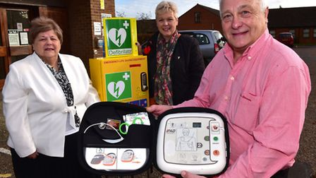 Fundraising has enabled the Connaught Hall committee in Attlebrough to install a defibrillator. Left