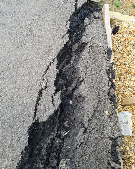 Sink holes remain in Nene Parade, March which is on the brink of collapse