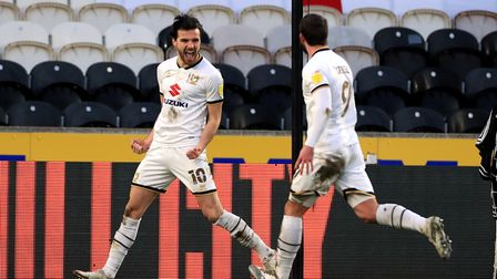 Milton Keynes Dons' Scott Fraser (left) celebrates scoring their side's first goal of the game with