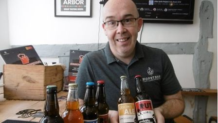 Ed Barnes pictured with a selection of ales at Hopsters in Ipswich