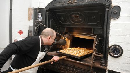 Palmers Bakery in Haughley. Kieron Palmer using the ancient brick ovens