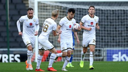 Milton Keynes Dons' Scott Fraser celebrates scoring his side's first goal of the game with team-mate