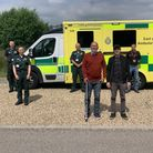 Father and son Peter and Paul Ellis, centre, visited the Waveney Ambulance Depot to thank life-savers.