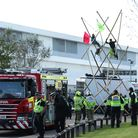 File photo dated 05/09/20 of police and fire services watching as protesters use bamboo lock-ons and