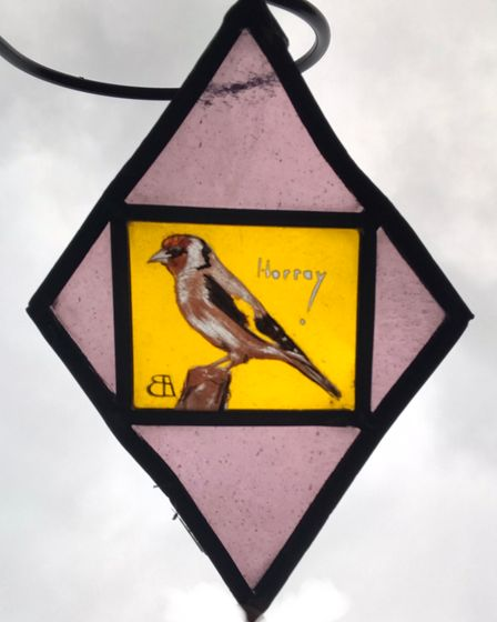 One of the glass bird paintings stolen from the churchyard at Cley.