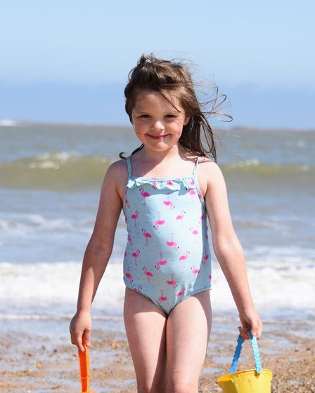 Maddie Connelly, five, enjoying the beach at Lowestoft on the first day of the hot weather. Picture: