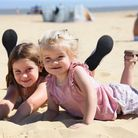 Sisters Presley, six, and two-year-old Isabella Eke from Carlton Colleville, enjoying the first day