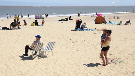 People enjoying the first day of the hot weather as the summer arrives at Lowestoft seafront. Pictur