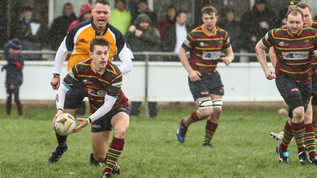 Chris Parrott in possession for Norwich on Saturday as the weather turns nasty at Beeston Hyrne. Pic