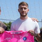 Adam Przybek, pictured with Wycombe boss Gareth Ainsworth (right) and goalkeeping coach Lee Harrison (left)