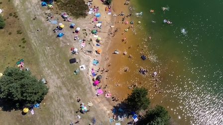 From above scores of people can be seen swimming in Bawsey Pits
