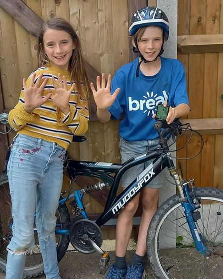Elodie and Patterson of Halvergate are cycling at least 10k every day for Break