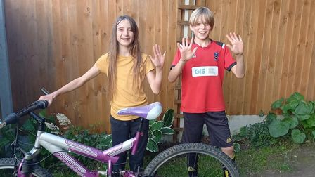 Elodie and Patterson covered 15k on day five of their cycling challenge for Break in the Halvergate area