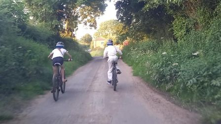 Elodie and Patterson of Halvergate are cycling at least 10k every day during the holidays for Break