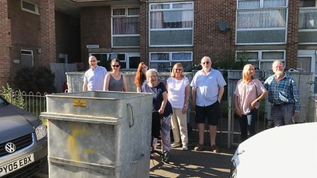 Members of BASSA pictured near the bins outside the flats.
