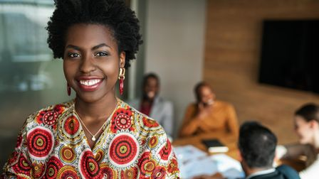 close up of beautiful young smiling professional black african business woman, coworkers hold a meet