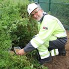 Graham Welham by Harry the hedeghog's new home at the substation site in Honington