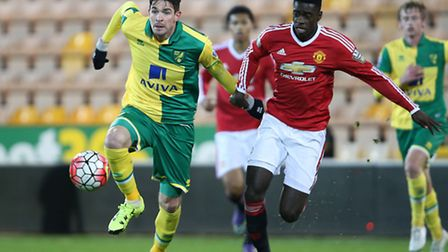 Kyle Lafferty of Norwich City U21s, left, with Axel Tuanzebe of Manchester United Under-21s at Carro