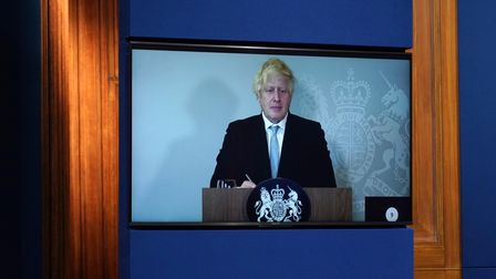 Prime Minister Boris Johnson appears on a screen from Chequers.