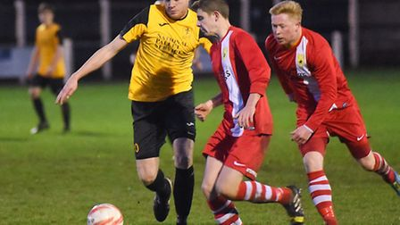 Action from Fakenham's 6-3 defeat against Newmarket, red, on Saturday. Picture: IAN BURT