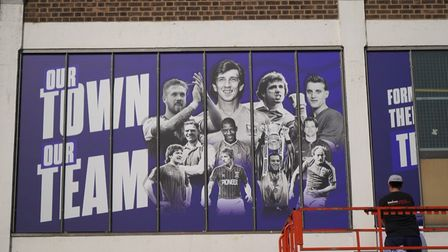 Images of iconic Ipswich Town players and moments have started to go up on the outside of the Cobbold Stand.