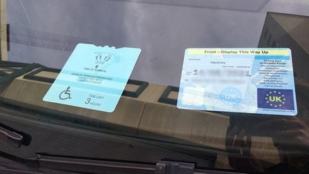 A blue badge, properly displayed on the front dashboard of a vehicle. Picture: Rhiannon Long