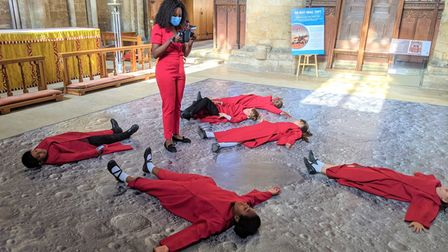 Choristers tried out making a moon footprint at Peterborough Cathedral