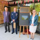 Martin Evans, left, Col David Dickey and centre chairman Judy Cloke after the rededicating of the 446th Bomber Group plaque.