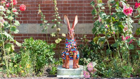 A hare painted in flags sits outside Eye Primary School.